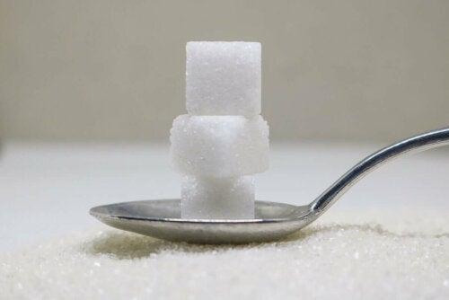 Sugar cubes on a spoon.