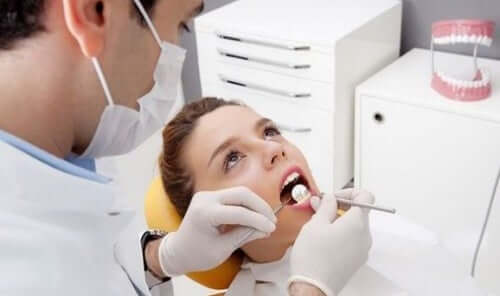 A woman at the dentist.