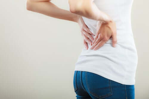 A woman with lower back pain.