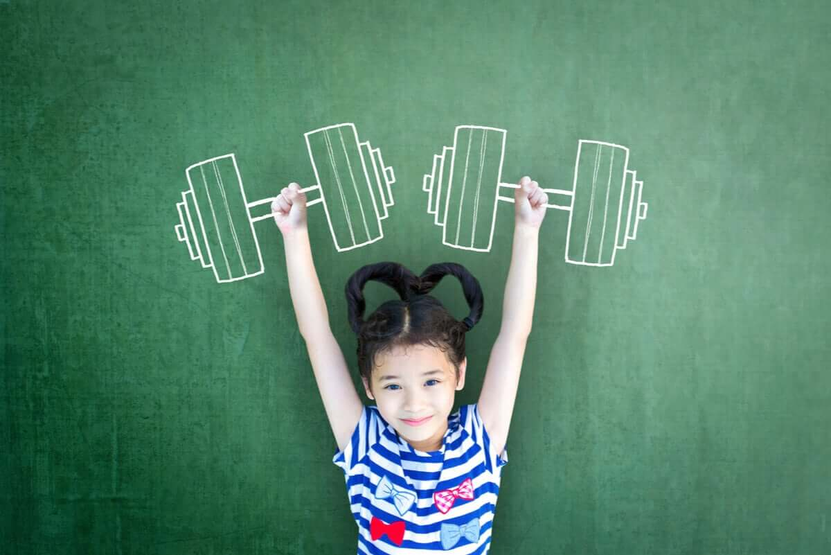 A small girl pretending to lift weights.