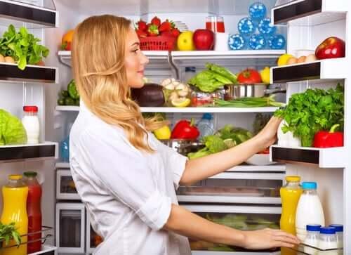 Woman looking in fridge.