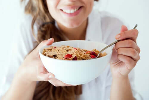 A woman eating breakfast - always start the day with breakfast!
