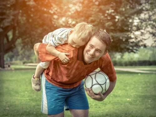 A child playing soccer with their father.
