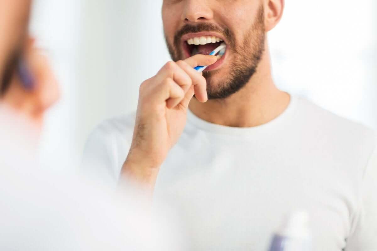 A man brushing teeth.