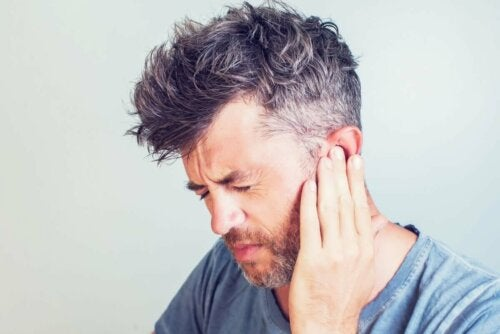 man with ear pain caused by vertigo
