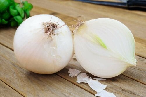 Two onions on a table.