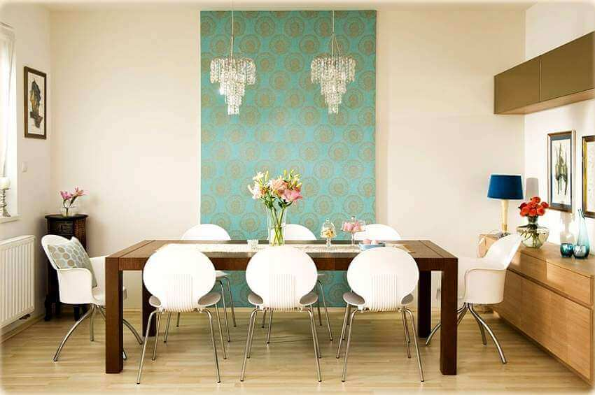 A dining room table with a table runner.