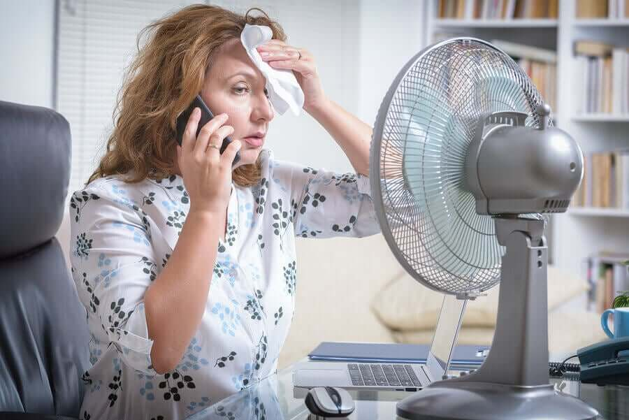 A woman suffering from heat stress.