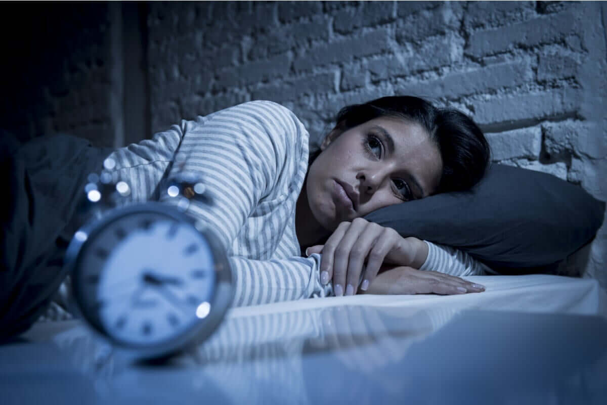 A woman suffering from nighttime anxiety.