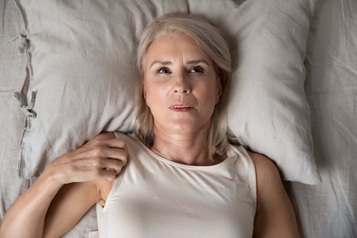 A woman who can't sleep at night due to anxiety.