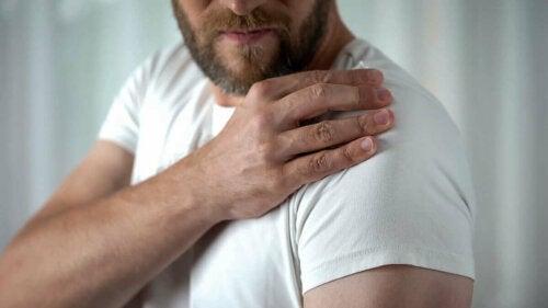 A man looking at his shoulder.