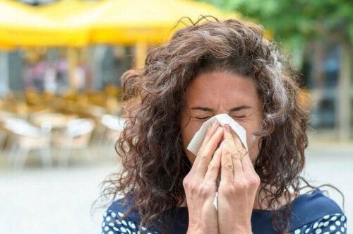 A woman blowing her nose.