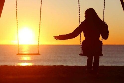 A woman on a swing.