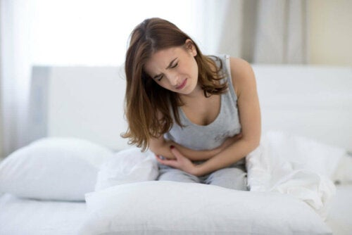 A woman with a stomach ache.