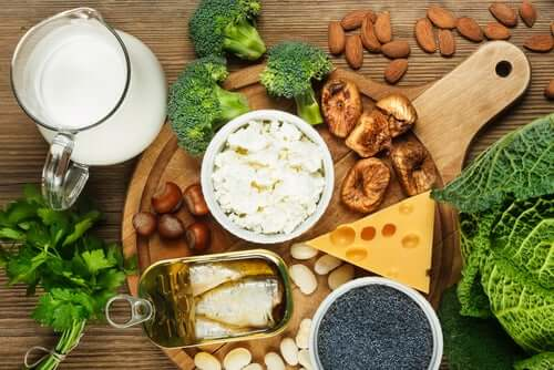 Foods rich in vitamin D, like cheese, oily fish, and milk.