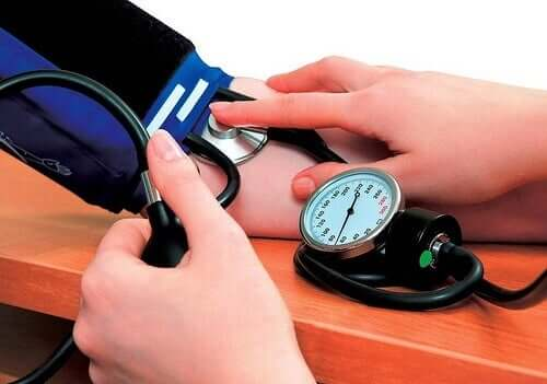 Measuring blood pressure.