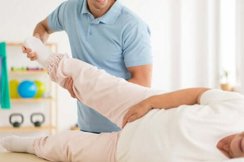A female adult undergoing physical therapy.