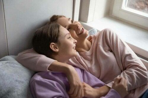 Two women lying down.