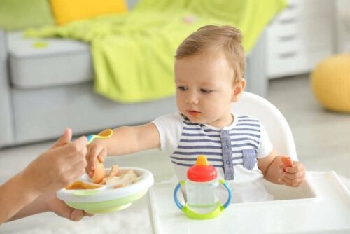 A baby eating new foods.