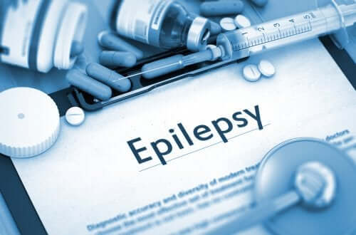 """Clipboard with medications and """"epilepsy"""" written on it."""
