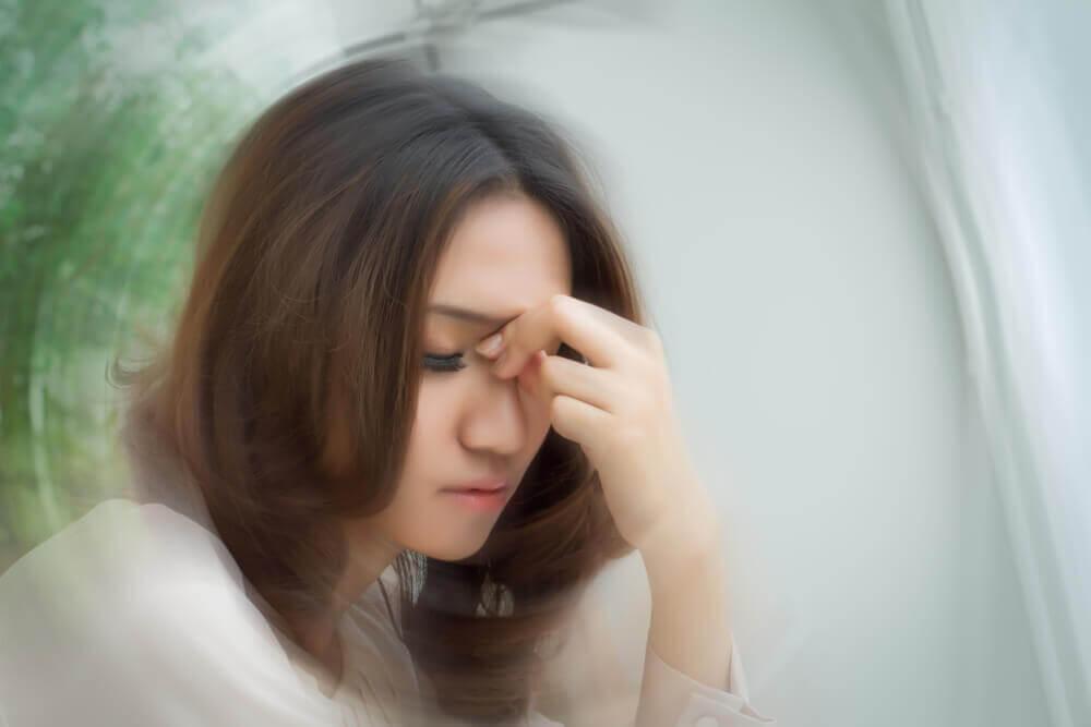 A woman feeling faint.
