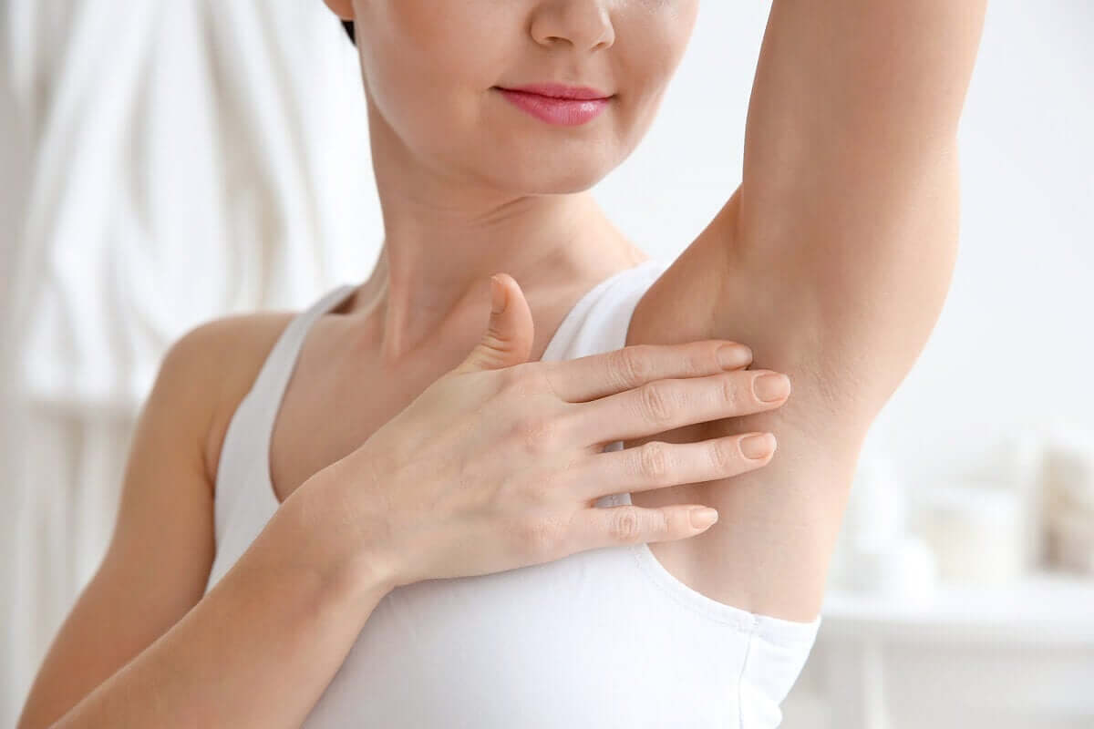 A woman with shaved armpits.