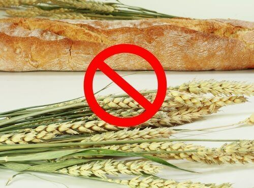 A baguette and some sprigs of wheat.