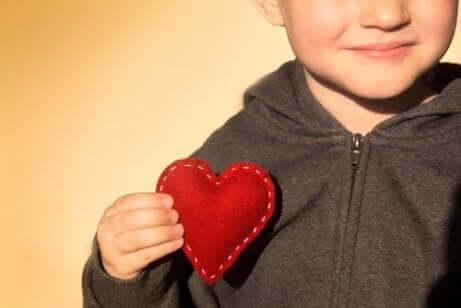 A child with a felt heart.