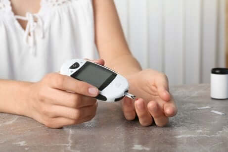 A person checking their blood sugar.