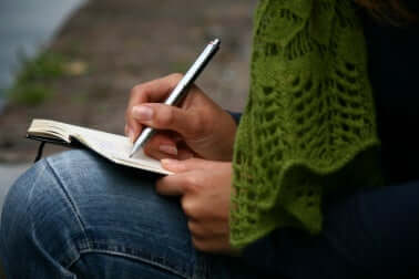 A person writing in a journal.