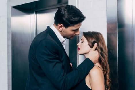 A seductive couple near an elevator.