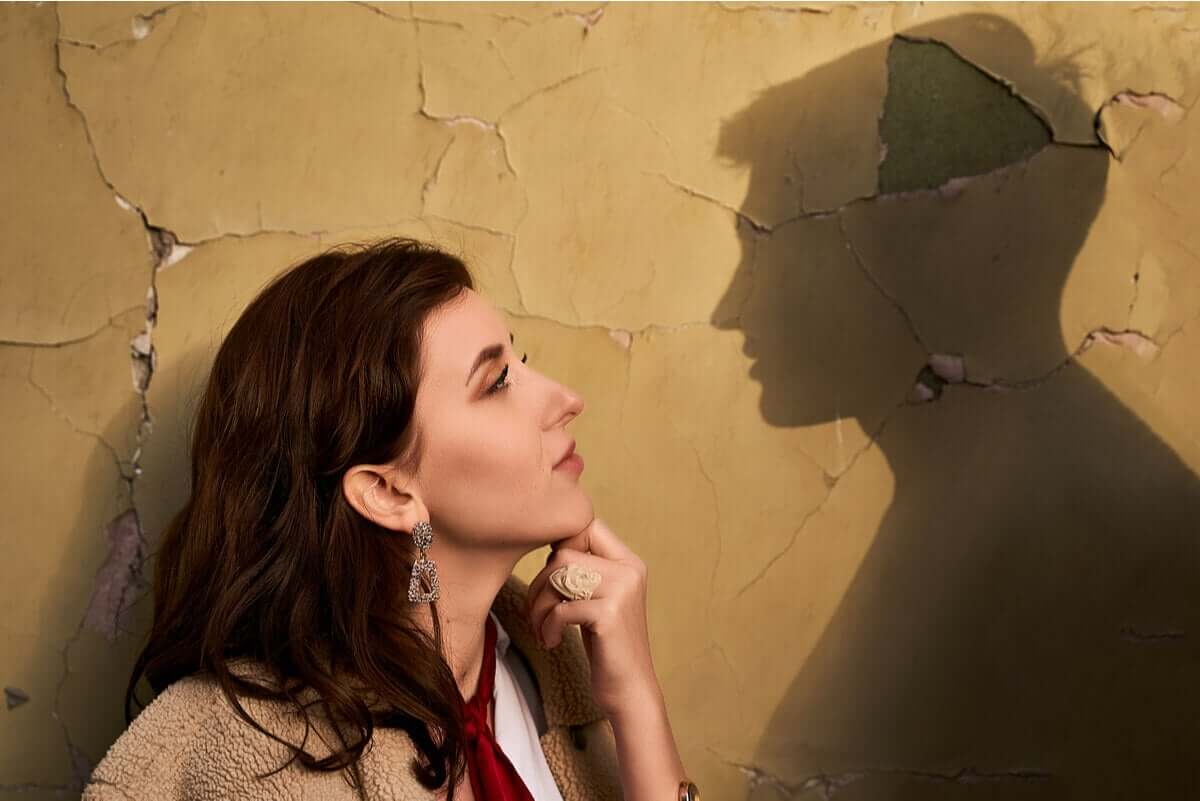 A woman looking longingly into the silhouette of her ex.