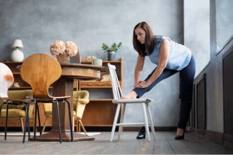 A woman stretching on a chair at home to be smarter
