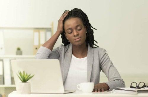 A woman with a headache.