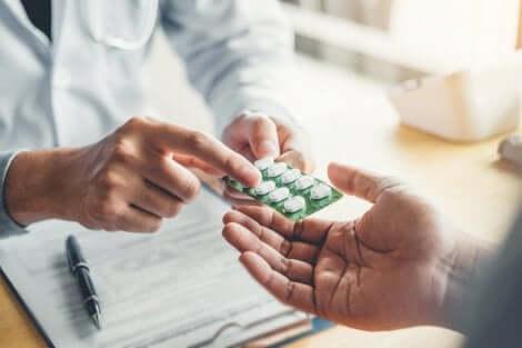 Pharmacist giving pills