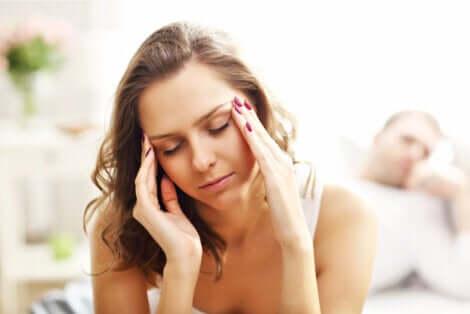 A woman suffering from a headache.