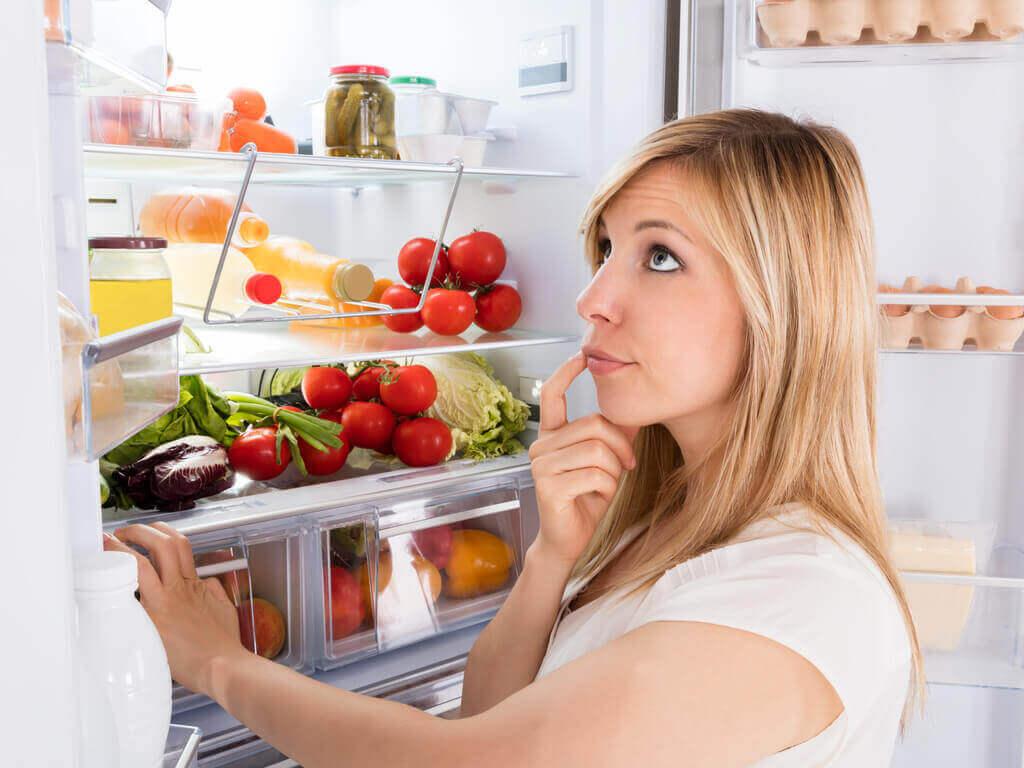 Woman looking in the fridge.