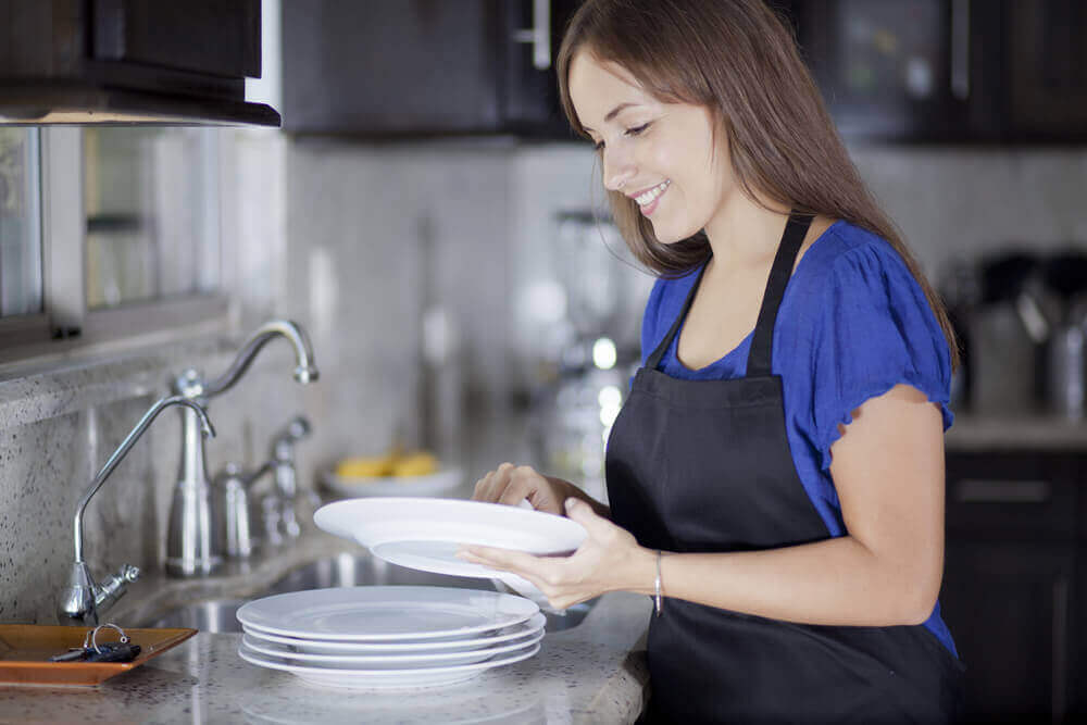 A woman washing dishes.