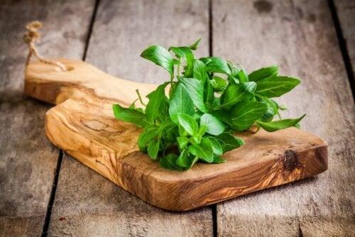 Basil on a chopping board.