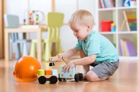 A little boy playing with toys.