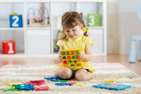 A child playing with numbers.
