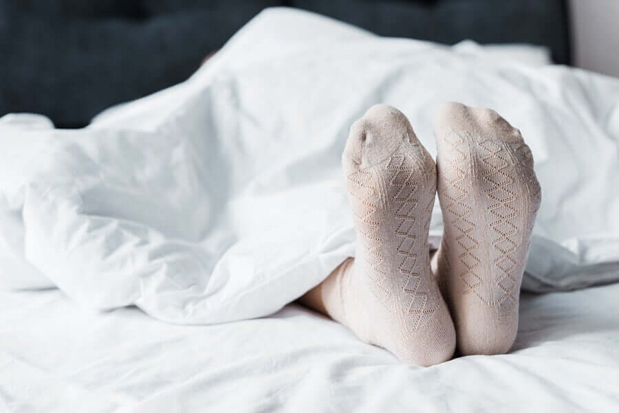 A person sleeping with socks on.