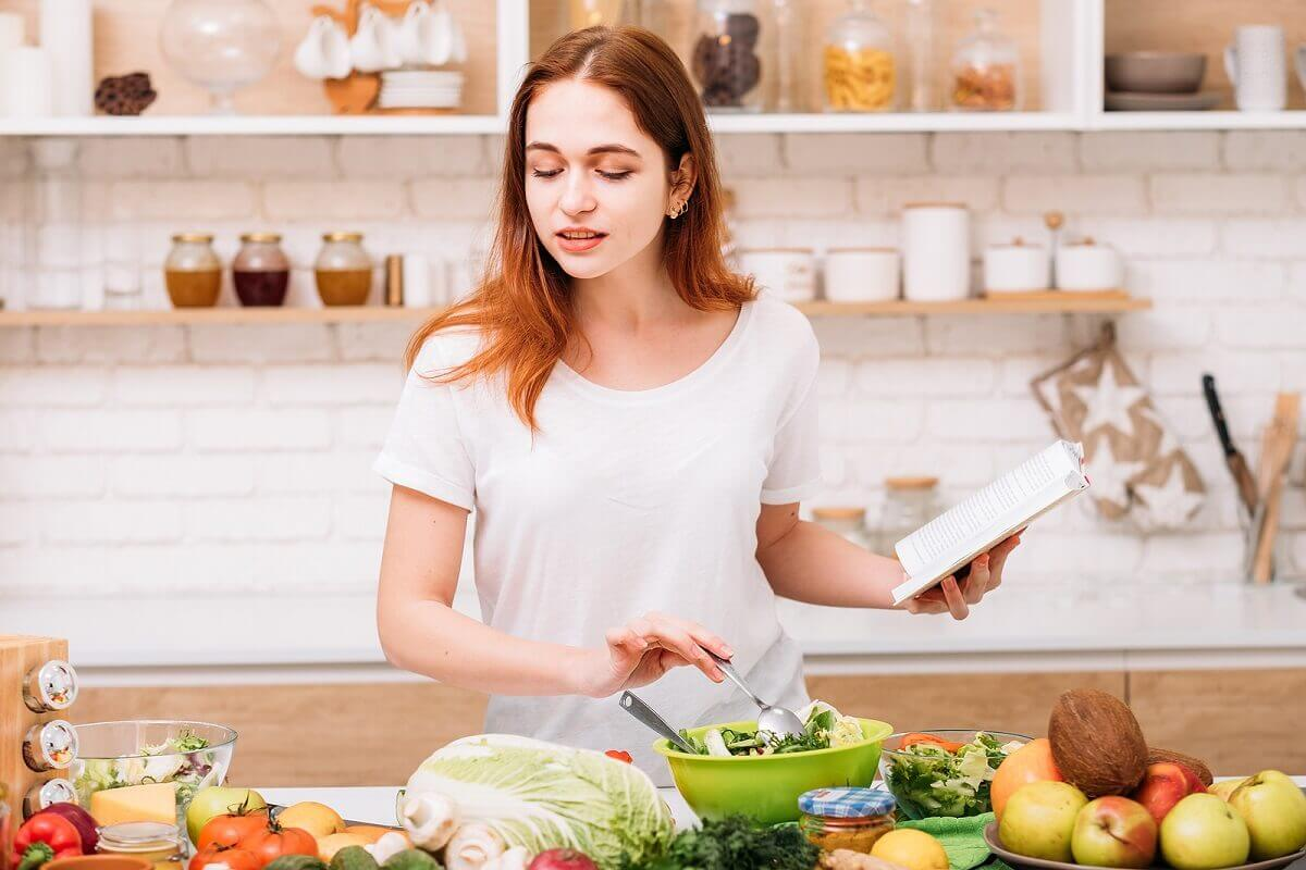 A woman cooking healthy food.
