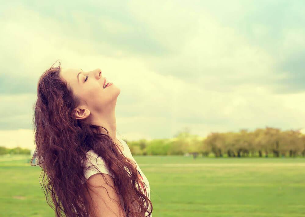 A woman in a field.