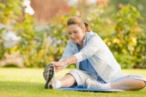 A woman stretching to prevent physical pain.