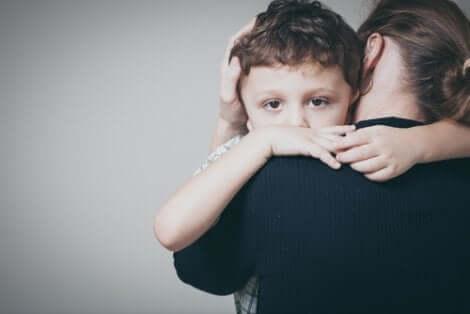 Child hugging mother.