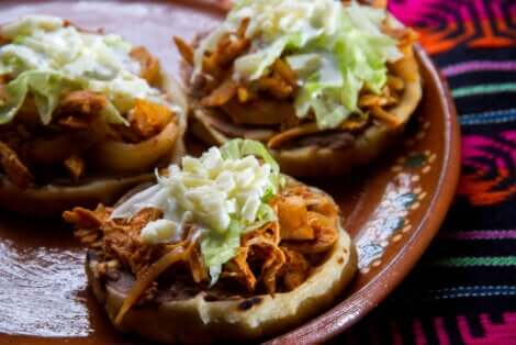 Mexican sopes on a plate.