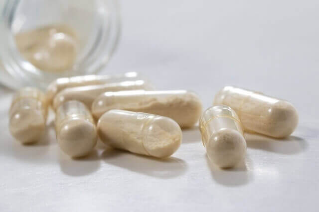 Weight-loss pills spilling out of a bottle.