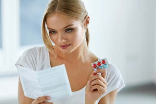 A woman reading the information about a medication.