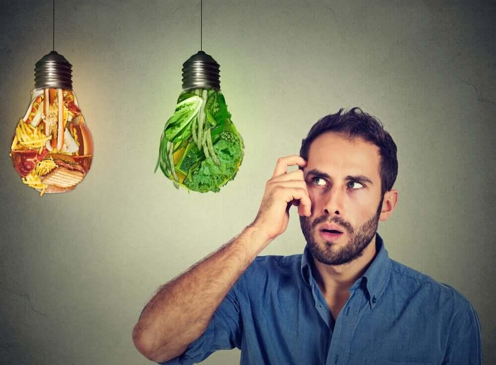 A man deciding on healthy or unhealthy foods.